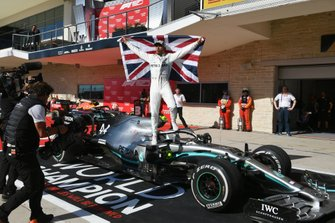 Lewis Hamilton, Mercedes AMG F1, 2nd position, celebrates with a Union flag after securing his sixth drivers world championship title