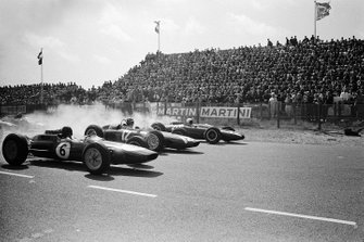 Jim Clark, Lotus 25 Climax, Graham Hill, BRM P57 and Bruce McLaren, Cooper T66 Climax