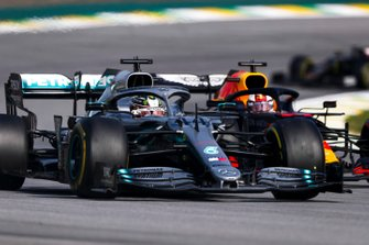 Lewis Hamilton, Mercedes AMG F1 W10 leads Max Verstappen, Red Bull Racing RB15 at the restart