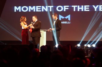Zak Brown, Executive Director, McLaren, presents the Moment of the Year award