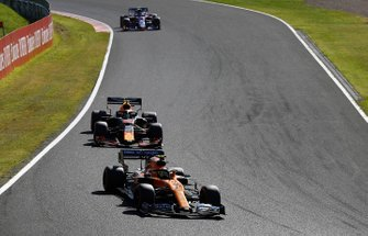 Lando Norris, McLaren MCL34, leads Alex Albon, Red Bull RB15, and Pierre Gasly, Toro Rosso STR14