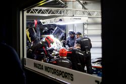 Mechanics working on the car of #70 Mazda Motorsports Mazda DPi: Joel Miller, Tom Long, James Hinchc