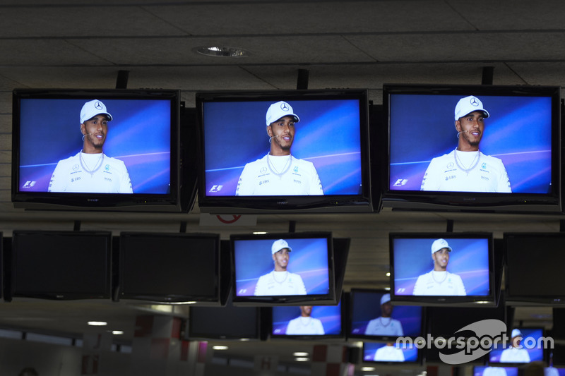 Lewis Hamilton, Mercedes AMG F1, is shown on the media centre TVs during the press conference