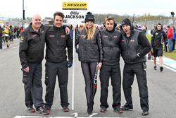 Lovely grid girl with AmD Tuning team members
