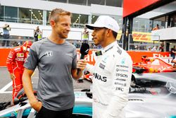 Lewis Hamilton, Mercedes AMG F1 W08, talks with Jenson Button after taking Pole Position