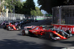 Kimi Raikkonen, Ferrari SF70H battles, Valtteri Bottas, Mercedes AMG F1 F1 W08 for position and collide at the start of the race