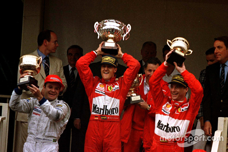 Podium: Race winner Michael Schumacher, Ferrari F310B; second place Rubens Barrichello, Stewart SF1