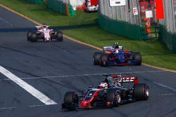 Romain Grosjean, Haas F1 Team VF-17, leads Carlos Sainz Jr., Scuderia Toro Rosso STR12, and Sergio P