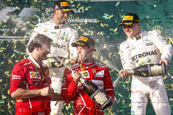 Sebastian Vettel, Ferrari, 1st Position, Lewis Hamilton, Mercedes AMG, 2nd Position, Valtteri Bottas, Mercedes AMG, 3rd Position, and Luigi Fraboni, Head of Power Unit Race Operation, Ferrari, celebrate with Champagne on the podium