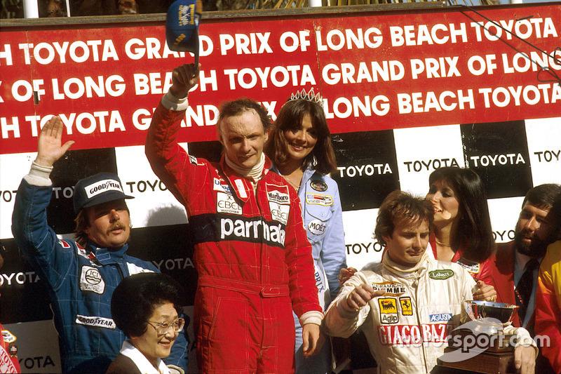 Ники Лауда, Кеке Росберг и Жиль Вильнев на подиуме Гран При США 1982 года