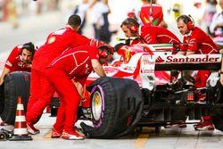 Ferrari engineers work on the car of Kimi Raikkonen, Ferrari SF70H