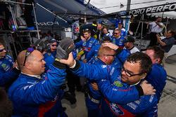 Chip Ganassi Racing team members celebrate their 1-2 finish
