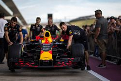 Red Bull Racing mechanics with Red Bull Racing RB13 in pit lane