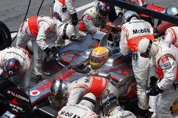 Lewis Hamilton, McLaren MP4-23, makes a stop
