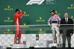 Kimi Raikkonen, Ferrari et Sergio Perez, Force India, sur le podium