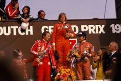 James Hunt, Hesketh, 1st position, Niki Lauda, Ferrari, 2nd position and Clay Regazzoni, Ferrari, 3rd position, on the podium