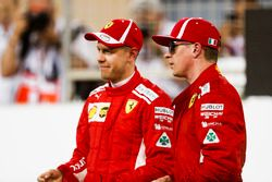 Prima fila: il poleman Sebastian Vettel, Ferrari, e Kimi Raikkonen, Ferrari