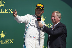 Lewis Hamilton, Mercedes AMG F1, is interviewed by Martin Brundle, on the podium