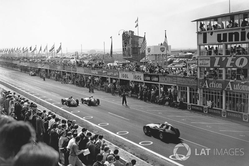 Juan Manuel Fangio, Maserati 250F, leads Stirling Moss, Vanwall VW10