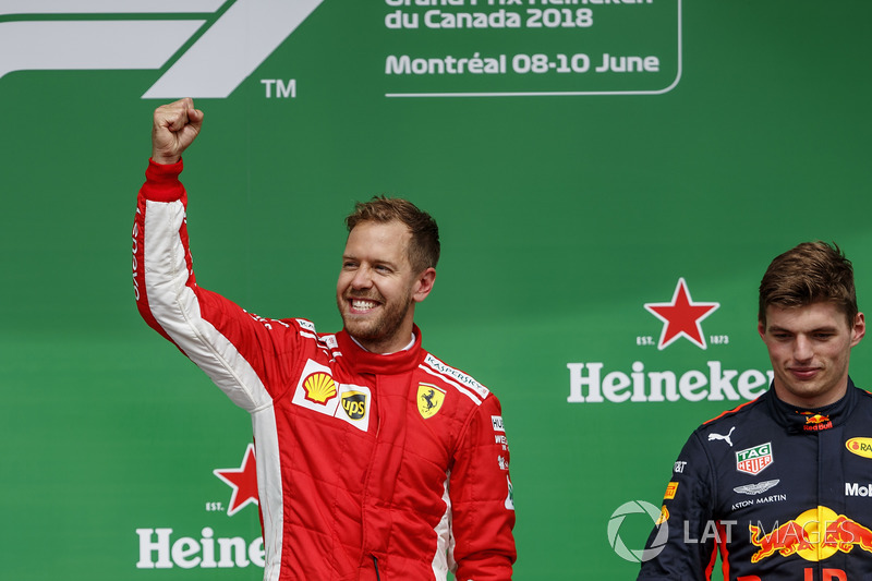 Sebastian Vettel, Ferrari, 1st position, celebrates alongside Max Verstappen, Red Bull Racing, 3rd p