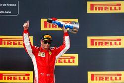 Kimi Raikkonen, Ferrari, 3rd position, with his trophy on the podium