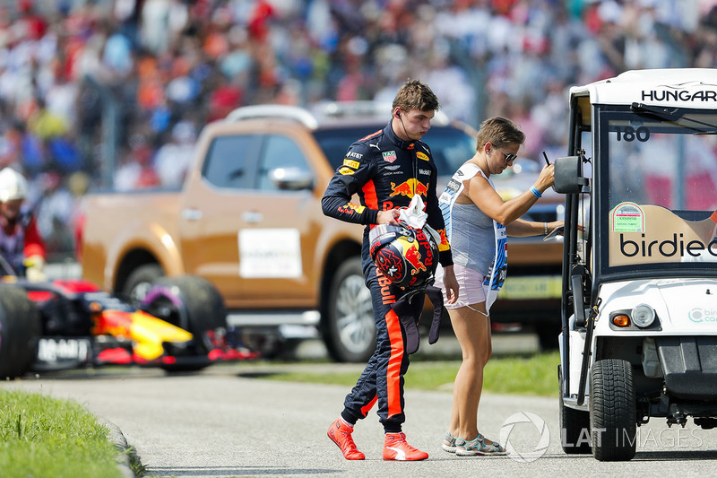Max Verstappen, Red Bull Racing, gets a lift back to the pits after retiring from the race