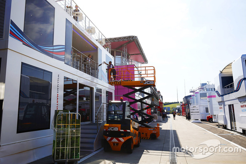 The Williams team prepare their hospitality unit in the paddock
