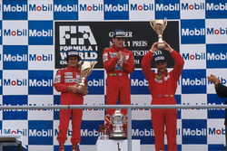 Podium: race winner Ayrton Senna, second place Alain Prost, third place Nigel Mansell