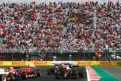 Alexander Rossi, Manor Marussia MR03, leads Kimi Raikkonen, Ferrari SF-15T, Fernando Alonso, McLaren