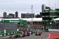 Sebastian Vettel, Ferrari SF16-H leads Nico Rosberg, Mercedes AMG F1 W07, Lewis Hamilton, Mercedes AMG F1 W07, Daniel Ricciardo, Red Bull Racing RB12, Max Verstappen, Red Bull Racing RB12 and the rest of the field at the start