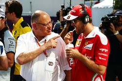 (L to R): Pat Behar, FIA with Sebastian Vettel, Ferrari on the drivers parade