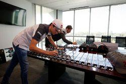 Romain Grosjean, Haas F1 Team, Esteban Gutierrez, Haas F1 Team sign items at Haas F1 Team