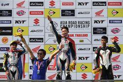 Podium race 1 Asia Production 250cc: winner Apiwat Wongthananon, second place Peerapong Loiboonpeng, third place Somkiat Chantra