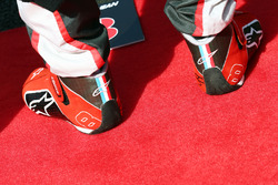 Racng boots of Romain Grosjean, Haas F1 Team as the grid observes the national anthem