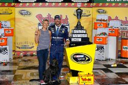 Race winner Martin Truex Jr., Furniture Row Racing Toyota with his wife, Sherry Pollex, and their dog, Boden