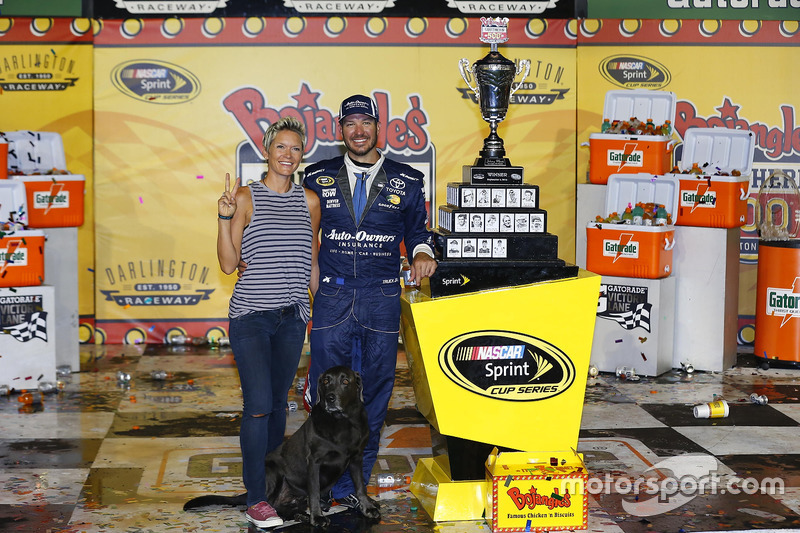Race winner Martin Truex Jr., Furniture Row Racing Toyota with his wife, Sherry Pollex, and their do