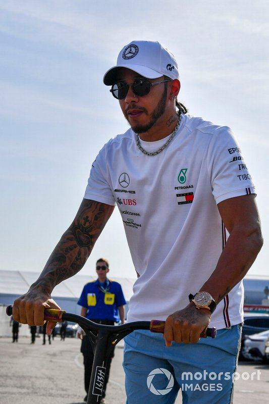 Lewis Hamilton, Mercedes AMG F1 arrives on a scooter
