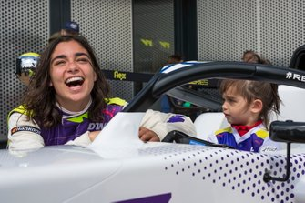 Jamie Chadwick with a young fan