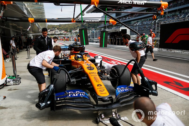 Lando Norris, McLaren MCL34, in the pits during practice