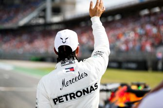 Lewis Hamilton, Mercedes AMG F1, waves to fans after securing pole