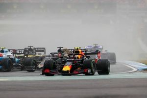 Pierre Gasly, Red Bull Racing RB15, leads Romain Grosjean, Haas F1 Team VF-19, and Robert Kubica, Williams FW42