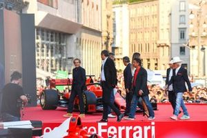 Alain Prost, Gerhard Berger, René Arnoux, and Arturo Merzario walk off the stage