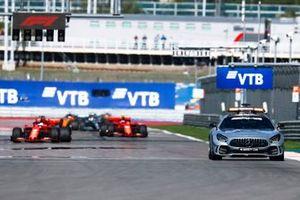 The Safety Car leads Sebastian Vettel, Ferrari SF90, Charles Leclerc, Ferrari SF90, Lewis Hamilton, Mercedes AMG F1 W10, and the rest of the field