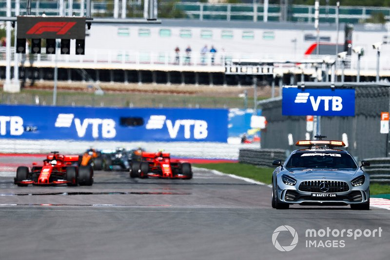 The Safety Car leads Sebastian Vettel, Ferrari SF90, Charles Leclerc, Ferrari SF90, Lewis Hamilton, Mercedes AMG F1 W10, and the rest of the field