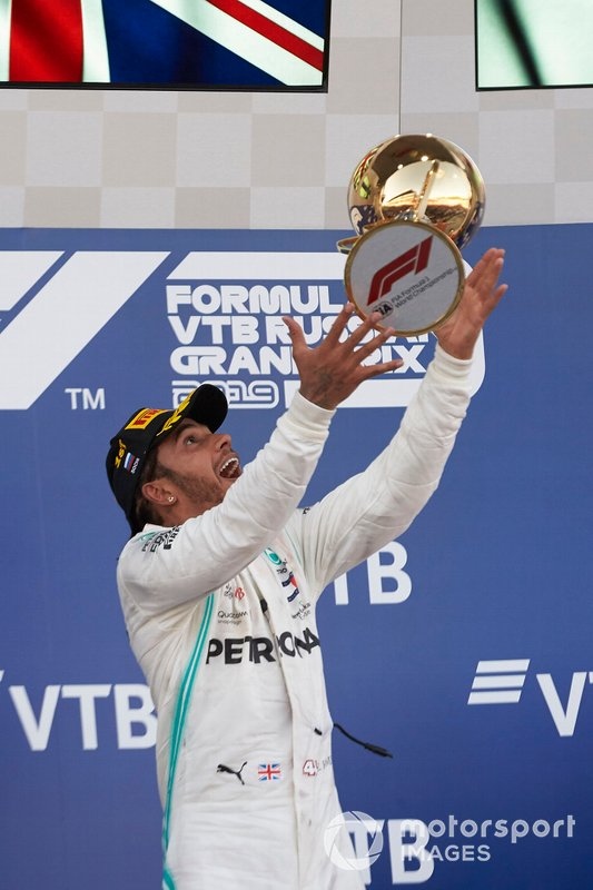 Lewis Hamilton, Mercedes AMG F1, 1st position, throws his trophy up in celebration