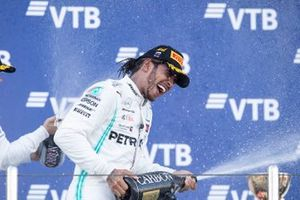 Second place Valtteri Bottas, Mercedes AMG W10 and race winner Lewis Hamilton, Mercedes AMG F1 W10 spray champagne on the podium