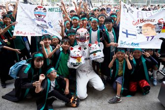 Lewis Hamilton, Mercedes AMG F1, or an impersonator, meets young fans