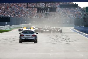 The Medical Car follows as the grid heads towards the first corner