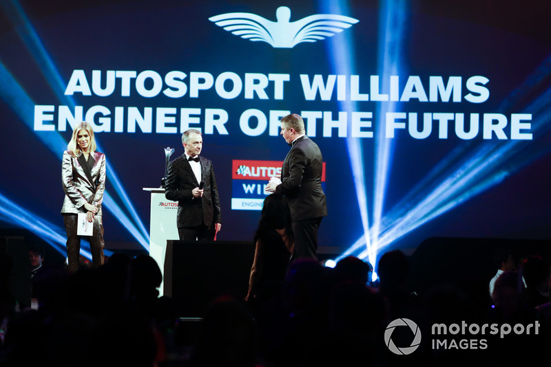 Nicki Shields and David Croft on stage with Paddy Lowe to present the Autosport Williams Engineer of the Future Award