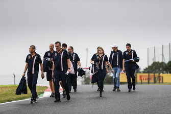 Esteban Ocon, Racing Point Force India, walks the track with his team